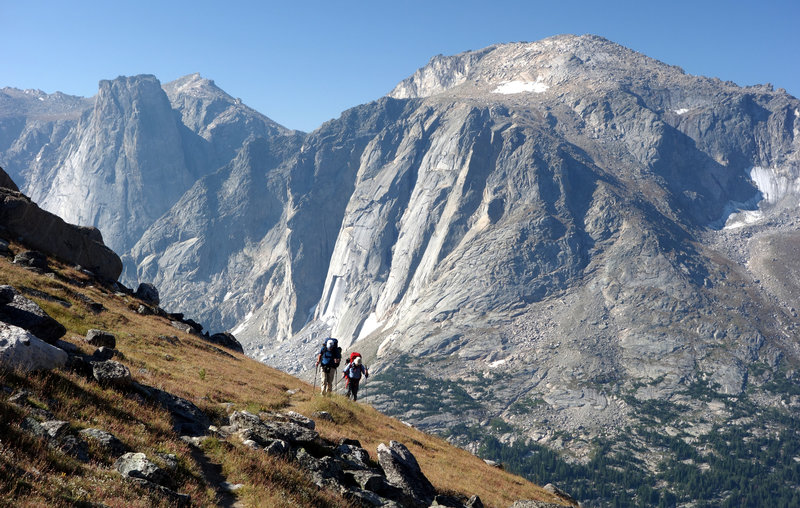 A group of hikers ascends the Lizard Head Trail with Lizard Head Peak in the distance.