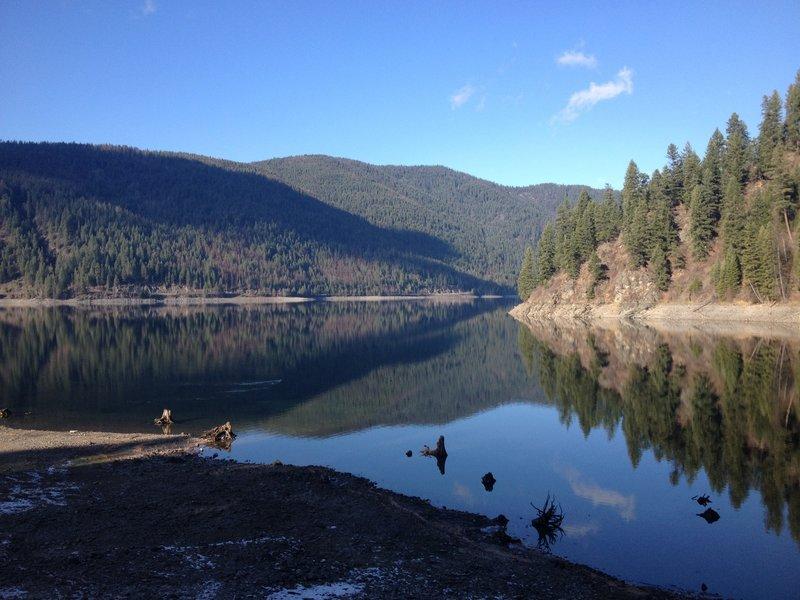 Sullivan Lake reflecting the surrounding mountains.