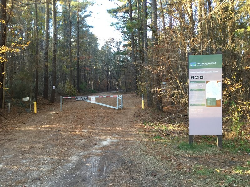 Reedy Creek Road / Trenton Road intersection gate entrance to Umstead State Park.