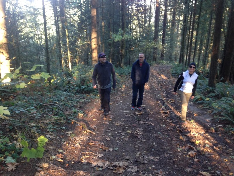 Three hikers out for a fall afternoon on the upper section of Fire Lane 5.