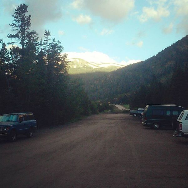 Sun coming up at the Herman Gulch Trailhead.
