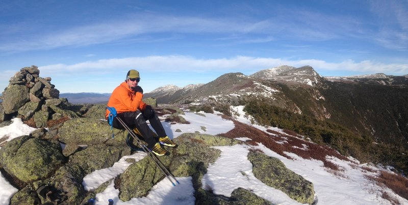 Taking a break on the Presidential Traverse, facing Mt. Washington. The famous Tuckerman's Ravine is down to the right.
