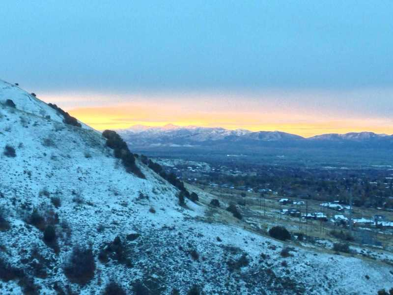 A view of the glorious sunrise over Ben Lomond and Willard Peaks from the King Nature Park North Ridge trail.