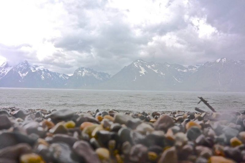 The Lakeshore Trail in Grand Teton National Park is a great place to take photos across Jackson Lake.
