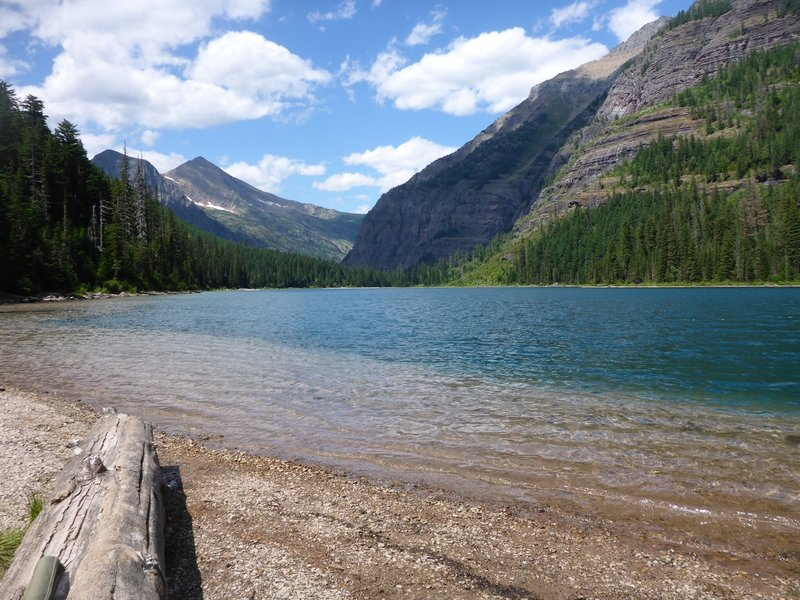 If you continue on the Avalanche Lake Trail past the first beach to the far end of the lake, swimming holes and a quieter shoreline await.