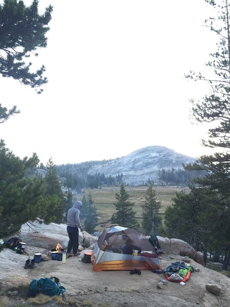 We set up camp on an empty spot overlooking the beautiful meadows at Sunrise High Sierra Camp. A few fire rings are available for use here! Also close to water and bathrooms.
