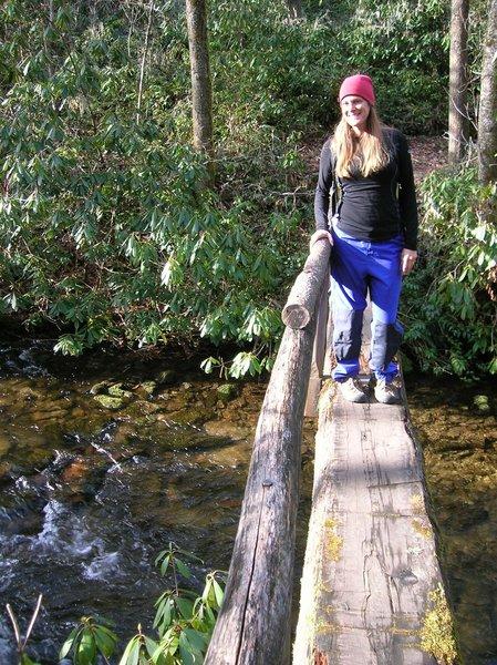 Log bridge crossing over Caldwell Creek on the way to Boogerman Trail.