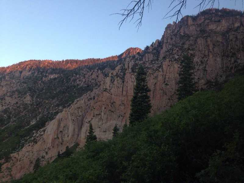 A view of the sun rising up over the Pine Valley Mountains as well as some of the amazing granite cliffs in the area.