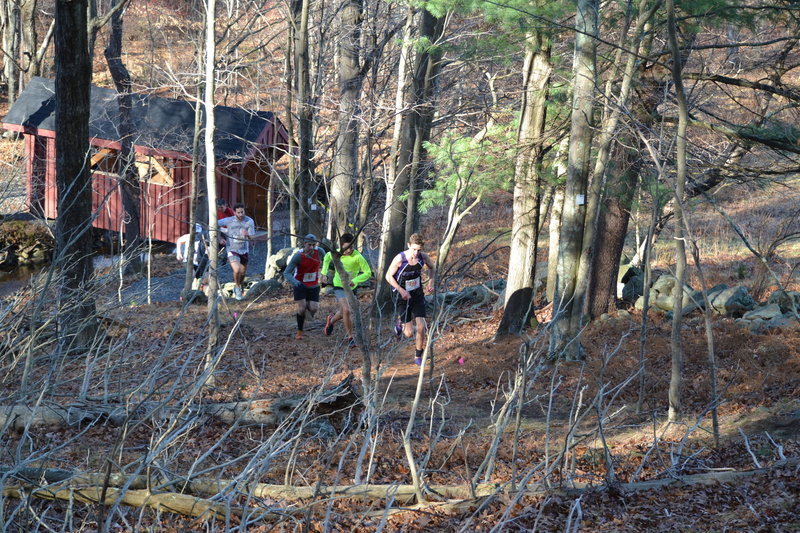Runners heading uphill from the new Covered Bridge.