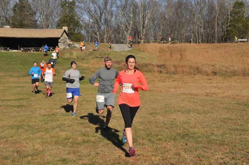 Runners crossing Michigan Road campground area.
