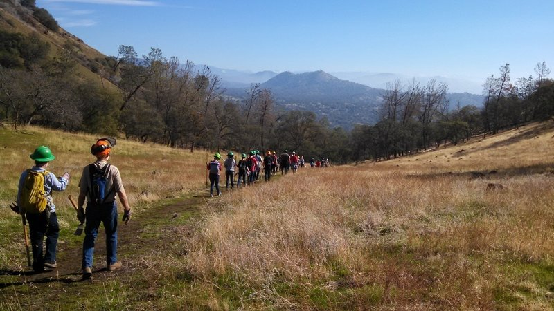 Volunteers and staff out working on the trail. View is East towards Prather and the Kings River watershed.