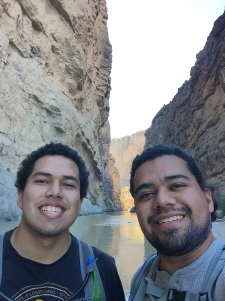 Standing on a rock in the middle of the Rio grande river, in Santa Elena Canyon trail at Big bend national park.