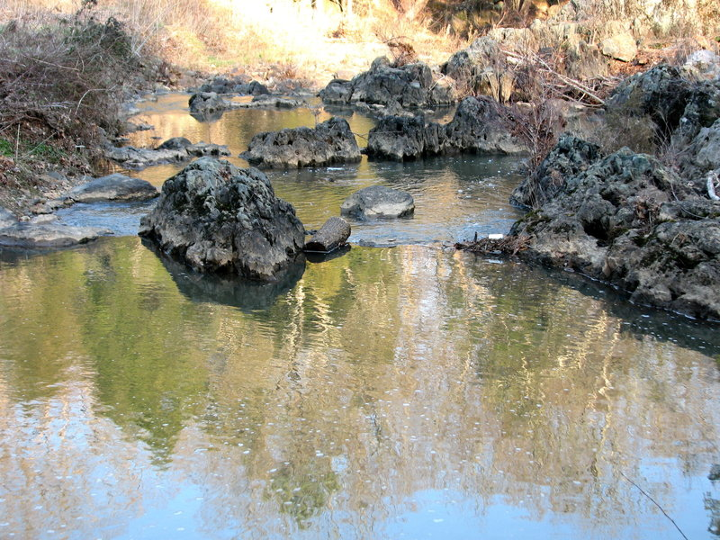 Reflection on rocks in creek at Johnston Mill.