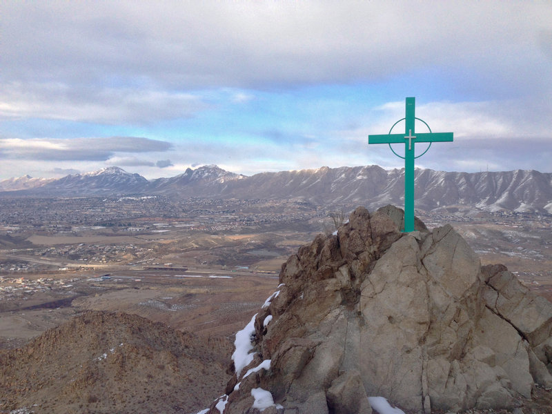 One of the trail's twelve stations of the cross, part of the Via Dolorosa. Sunland Park, western El Paso, and the Franklin Mountains are in the background.