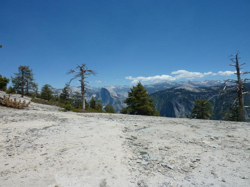 Rocky top of El Cap - View of Half Dome.