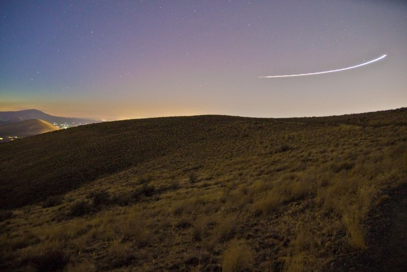 The Skyline Trail is even spectacular after the sun goes down, as subdivision glow illuminates the horizon, while a comet streaks past.