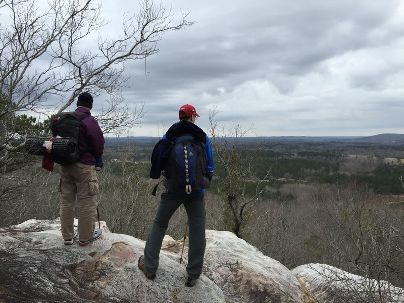 A couple hikers pausing to take in the view along the Pine Mountain Trail.
