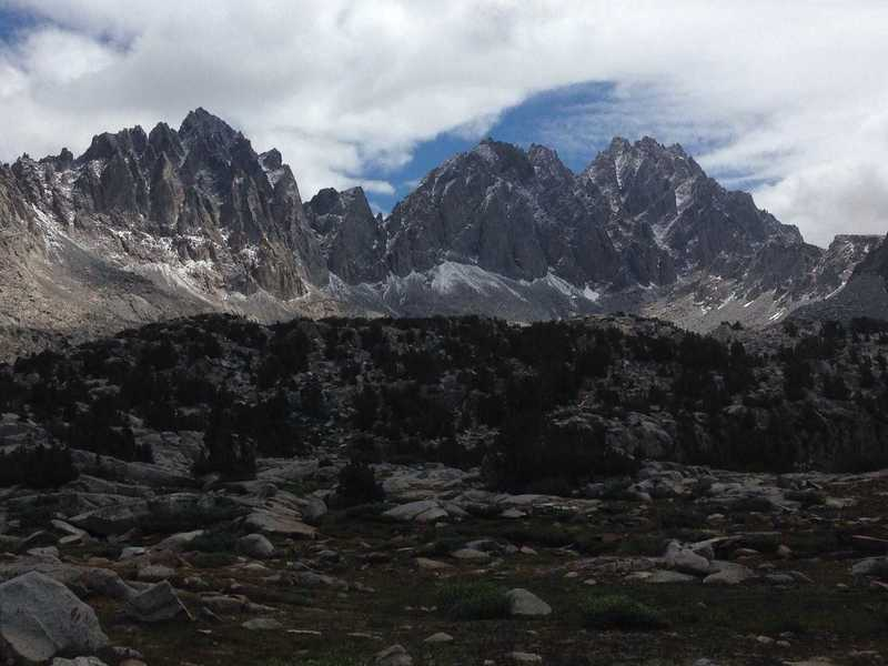 A view of (from left to right) Mount Winchell, Thunderbolt Peak and the North Palisade from Dusy Basin, dusted by a small July snowstorm
