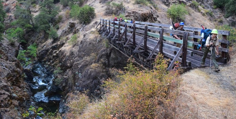A trail crew crosses over Mule Creek.