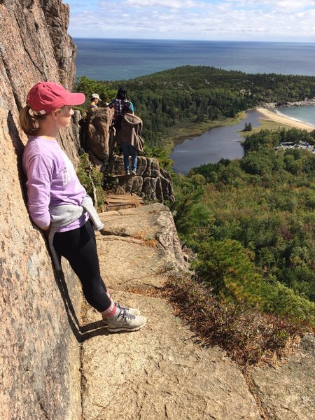 Enjoying the stunning view from one of the narrower ledges of the Beehive Trail.