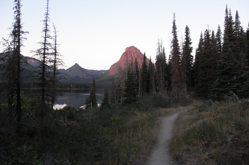 Starting the Loop Hike (going clockwise) before sunrise. Sinopah Mountain yielded an incredible alpenglow in the first mile on the trail along Two Medicine Lake.