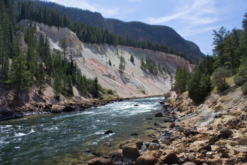 Looking up the Yellowstone River from Seven Mile Hole. The black stains on the right side of the canyon are from small hot springs seeping into the river.