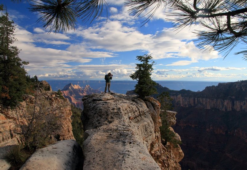 Out on a North Rim Ledge taking some photos. Picture by Jim McNutt
