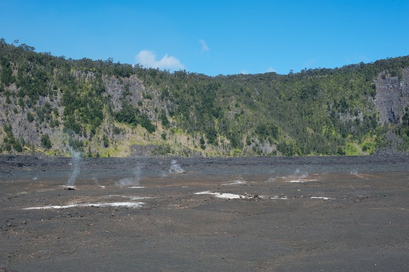 Steam venting up from the magma core through the crater floor.
