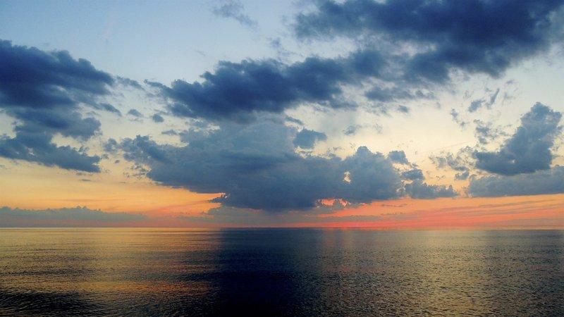 A rare, perfectly calm Lake Michigan at sunset. Killer colors.