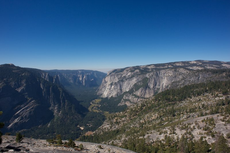 View of Yosemite Valley, 3 Brothers, El Capitan, and Sentinel Dome from North Dome. One of the spectacular views you get from this hike.