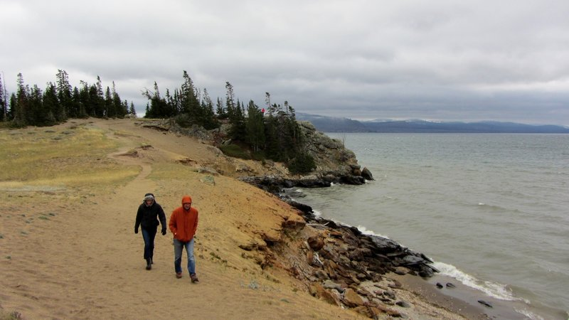 Hikers bundle up as they leave Storm Point on a stormy September afternoon.
