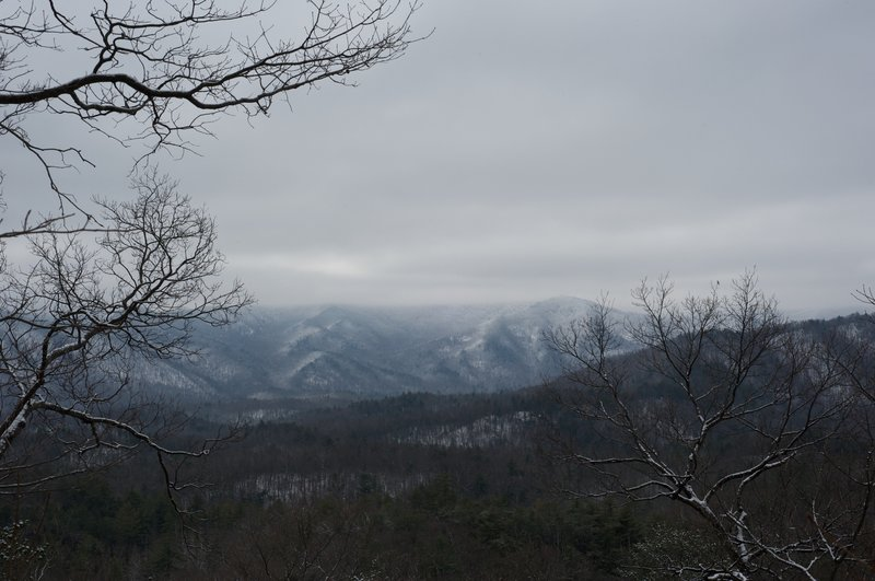 There are clearings along the trail that open up and the crest of the Smokies are visible on clear days. Here, snow covers the crest.