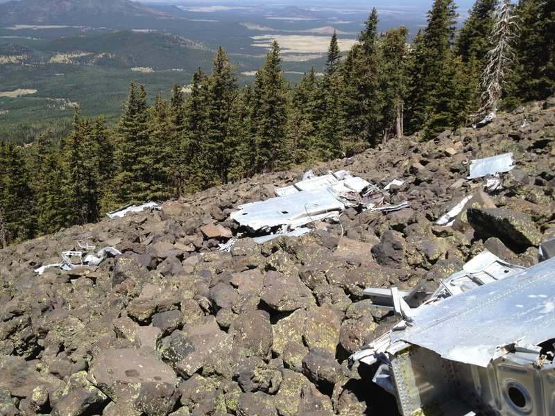B-24 wreckage on steep rocky slope.