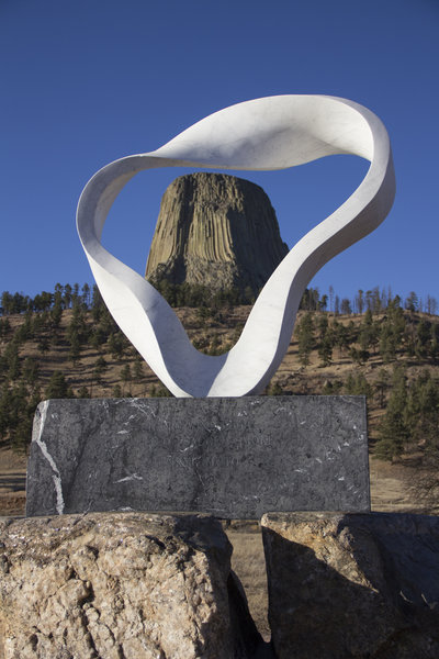 Viewing Devils Tower through the Circle of Sacred Smoke sculpture.