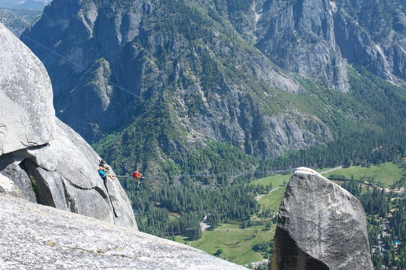 Watching slack liners high above Yosemite Valley at the Lost Arrow.