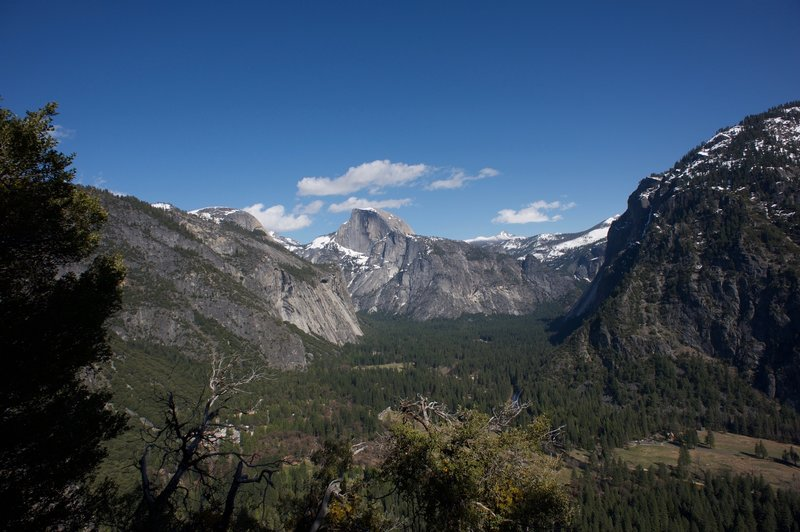 The view up the Yosemite Valley. North Dome on the left, Half Dome in the middle, and the Glacier Point on the right. Great views open up in this section of the Upper Yosemite Trail.