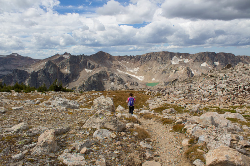 Hiker and Mica Lake along trail descending from Paintbrush Divide.