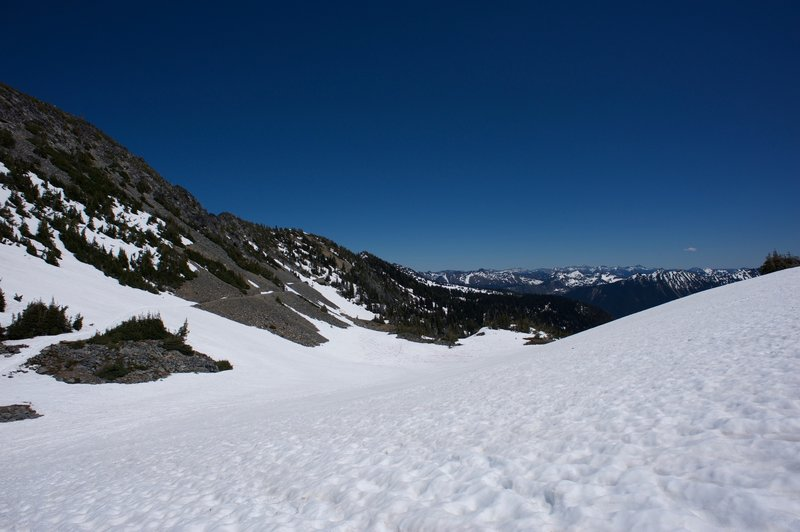 The trail follows the ridge back to Sunrise.