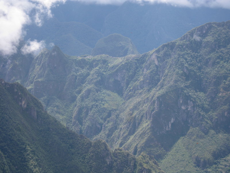 One of the reasons people take the Salkantay route to Machu Picchu is that you get a unique view of the ruins that few people see. Here, in the upper middle section of the photo, is our first view of Machu Picchu. You can see the terracing on the downslope.