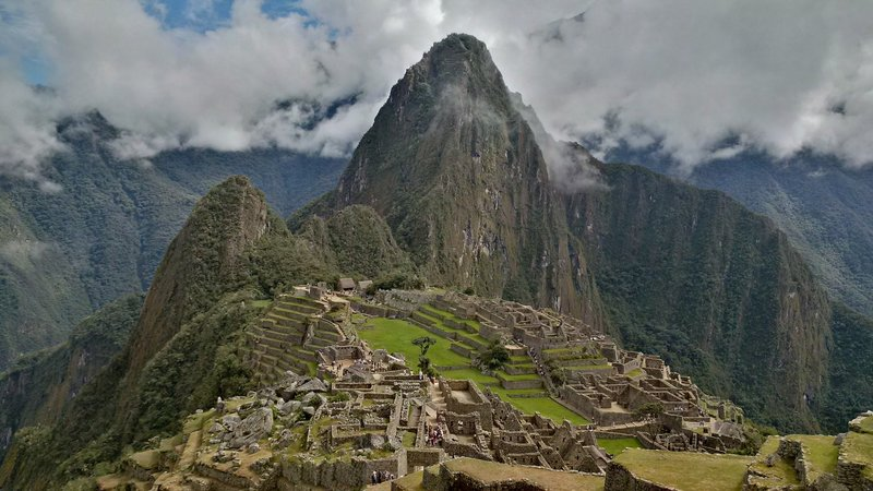 Money shot!  The ruins photographed from a common viewing point.  The taller peak in the background is Wayna Picchu (or Huayna Picchu), and it is possible to climb to the top for a different view of the ruins.  You need a special permit to do this - check it out before you go.