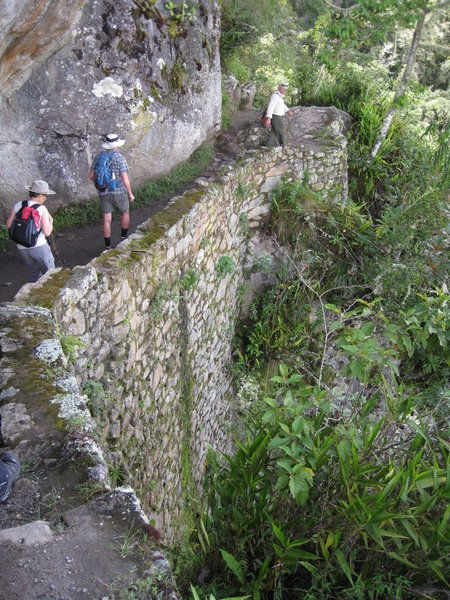 """A side trail when in the Machu Picchu park goes out to the """"Inca Bridge"""".  You can't get all the way down to the bridge, but it's a fun walk atop steep walls down to the viewing point."""