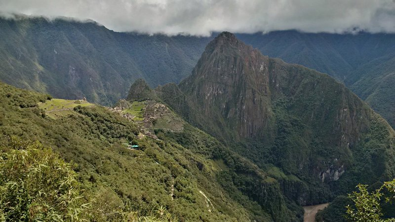 """The view of the ruins you see when you enter from the Sun Gate.  The traditional """"Inca Trail"""" brings visitors in this way.In ancient times, this was a (maybe the) main entrance."""