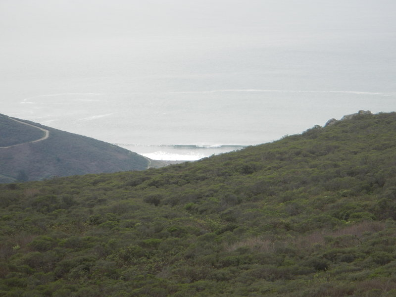 View from the top looking at surfers scrambling to get over this set wave at Muir Beach.