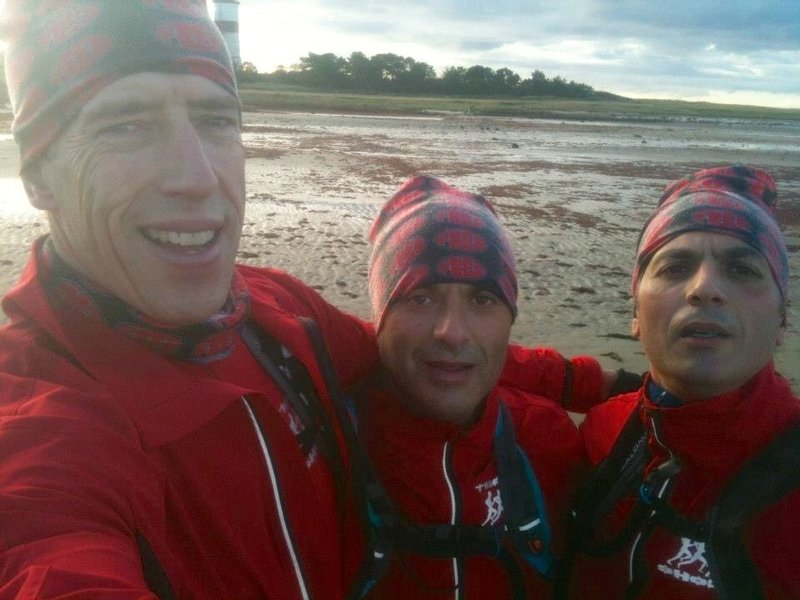 At the finish line with the lighthouse behind us!