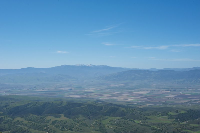 A view toward the west, with farmland and mountains in the distance.