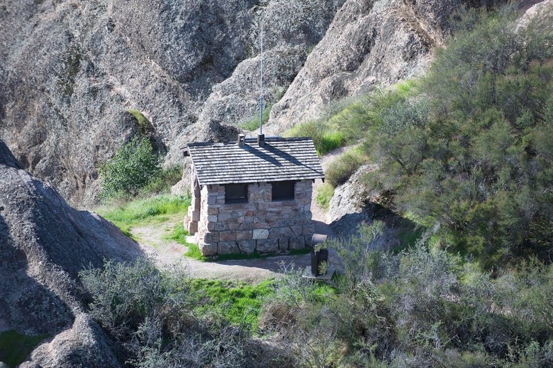 A little outhouse and trash can for hikers who need a break.
