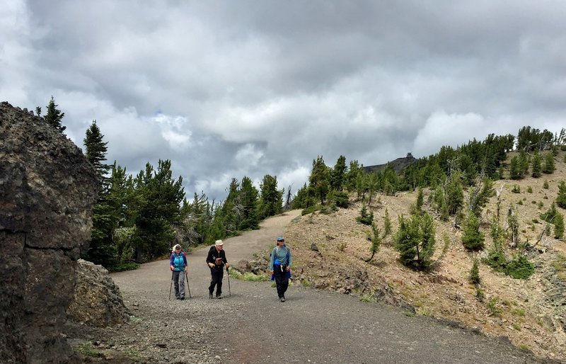 Hikers returning from a rewarding trip to the top of Mount Washburn (the Washburn Fire Lookout is visible on the upper right).