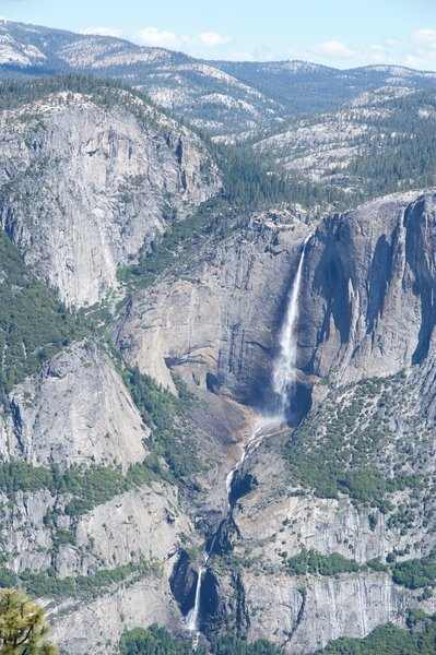 Upper Yosemite Falls, Middle Cascades, and Lower Yosemite Falls. You can see Upper Yosemite Falls Trail snaking its way to the top of the Valley Rim.