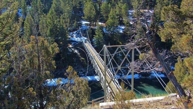 A steel suspension bridge (built in 1936) that crosses the Yellowstone River.