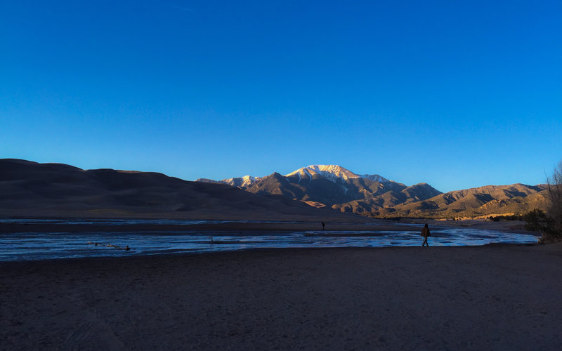 Views of sand peaks and mountain peaks abound in Great Sand Dunes National Park.